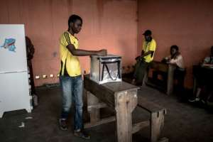 Polling in DR Congo on Sunday was relatively peaceful -- the focus has now shifted to the vote count.  By JOHN WESSELS (AFP)