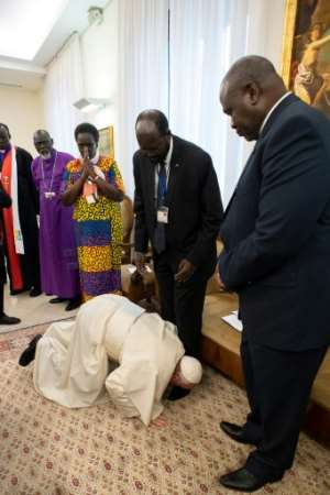 Pope Francis stunned the world by kissing the feet of the two men accused of responsibility for heinous war crimes.  By Handout (VATICAN MEDIA/AFP/File)