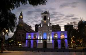 Portraits of essential workers are projected on the facade of the Cabildo of Buenos Aires. Latin America is the worst-hit region and is still struggling with its first wave of coronavirus infections.  By ALEJANDRO PAGNI (AFP)
