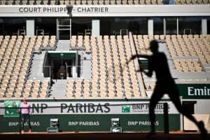 Players take part in a French Open warm-up session without spectators at Roland Garros.  By Anne-Christine POUJOULAT (AFP)