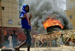 Plumes of smoke from burning tyres set ablaze by demonstrators rose over Khartoum.  By Ebrahim Hamid (AFP)