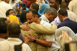 Protest leaders celebrate after the signing of the constitutional declaration with Sudan's army rulers.  By ASHRAF SHAZLY (AFP)