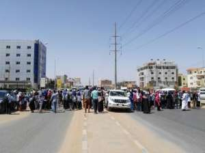 Protesters march during an anti-government demonstration in Street 60 in the Sudanese capital Khartoum. By - (AFP)