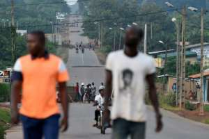 Protesters mounted barricades in the flashpoint town of Daoukro.  By SIA KAMBOU (AFP)