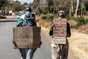 Protesters at an anti-corruption march in July.  By ZINYANGE AUNTONY (AFP/File)