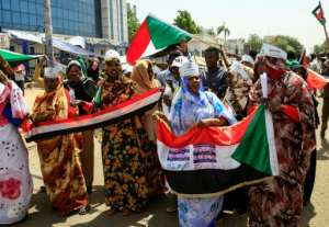 Protesters chant slogans during a rally outside the army headquarters in Sudan's capital Khartoum.  By Ebrahim Hamid (AFP)