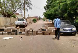 Protesters have thrown up makeshift barricades on many minor roads in residential districts of Khartoum.  By - (AFP)