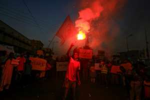 Protesters in Khartoum on July 4 rally in solidarity with people in parts of Darfur province following recent incidents of killings and looting there.  By ASHRAF SHAZLY (AFP/File)
