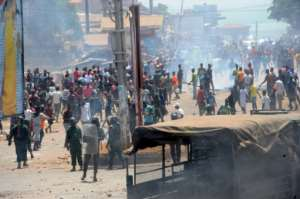 Protestors clashed with anti-riot police in Conakry on Monday -- demonstrations against Guinean President Alpha Conde have unfolded almost daily since disputed elections on February 4.  By CELLOU BINANI (AFP)