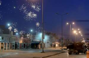 Protests broke out on Friday night; this photograph taken on January 17 shows demonstrations in suburbs surrounding the capital Tunis.  By FETHI BELAID (AFP)