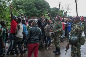 Protests have broken out in the Malawian capital Lilongwe following accusations that bribes were offered to the five judges on the case.  By Amos GUMULIRA (AFP/File)