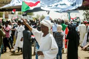 Protests outside Khartoum's army headquarters are now in their seventh day. By MOHAMMED HEMMEAIDA (AFP)