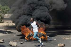 Protests over cost of living and wages are common as Zimbabweans still struggle to survive.  By STRINGER (AFP)