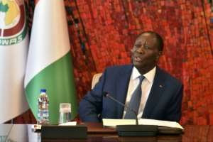 President Alassane Ouattara is viewed by many as a stablising figure, but any bid for a third term may trigger accusations of authoritarianism.  By SIA KAMBOU (AFP)