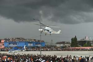 President Alassane Ouattara used a helicopter to make a dramatic appearance at his final rally on Thursday.  By SIA KAMBOU (AFP)