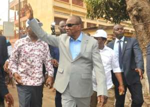 President Alpha Conde of Guinea waved after casting his vote outside a polling station in Conakry.  By CELLOU BINANI (AFP)