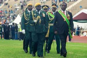 President Emmerson Mnangagwa, right, lashed out at new price hikes in Zimbabwe as the country marked its 39th independence anniversary.  By Jekesai NJIKIZANA (AFP/File)