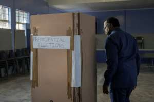 President Hage Geingob was the first to vote at Mandume primary school in the capital Windhoek.  By GIANLUIGI GUERCIA (AFP)