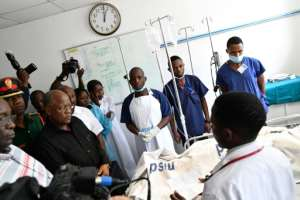 President John Magufuli visited Muhimbili National Hospital in Dar es Salaam to talk to victims and medical staff.  By STRINGER (AFP)