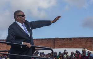 President Mutharika, seen here at independence day celebrations last July, has fallen out dramatically with Chilima.  By Amos Gumulira (AFP)