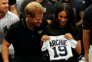 Prince Harry and Meghan were presented with gifts for Archie when they met New York Yankees players earlier this year.  By PETER NICHOLLS (POOL/AFP/File)