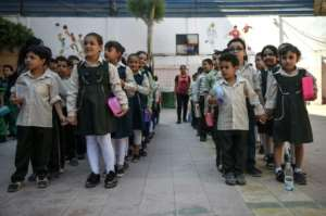Pupils line up in the courtyard of the Mahaba school, which was founded 30 years ago by the pioneering anti-poverty activist Sister Emmanuelle.  By Mohamed el-Shahed (AFP)