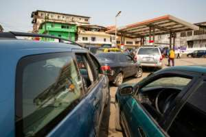 Queues at fuel stations often now start forming before the sun comes up.  By Carielle Doe (AFP/File)