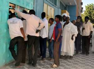 Queuing has become a way of life in Sudan -- at bakeries, petrol stations and ATM machines -- as a collapse in hard currency earnings has led to chronic shortages of cash and basic goods.  By EBRAHIM HAMID (AFP/File)