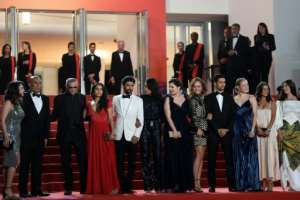 Questions have been raised whether the latest film from French-Tunisian director Abdellatif Kechiche (3rd left) will ever be released. By CHRISTOPHE SIMON (AFP)