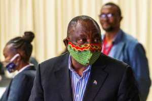 Ramaphosa was mocked on social media for fumbling while putting on a face mask.  By Jerome Delay (POOL/AFP/File)