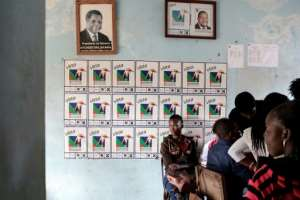 Renamo supporters register in Xai-Xai for the election, which ruling party Frelimo is expected to win.  By GIANLUIGI GUERCIA (AFP)