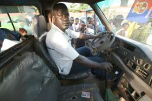 Ready to go: Marcel Zouh, a bus driver in Daloa, says he would emigrate to Europe at the drop of a hat.  By Sia KAMBOU (AFP)