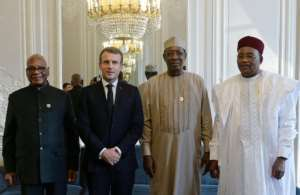 Receiving his counterparts from Mali, Chad and Niger at the Elysee Palace, President Macron said France is committed to helping their nations resolve regional conflict.  By JOHANNA GERON (POOL/AFP)