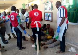 Red Cross workers attend to victims of Sunday's triple suicide bombing in Konduga.  By Audu Ali MARTE (AFP)