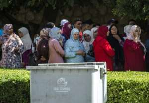 Relatives of men accused by a Moroccan teenager of gang-rape wait outside a courthouse in the central Moroccan city of Beni Mellal on October 10, 2018.  By FADEL SENNA (AFP)
