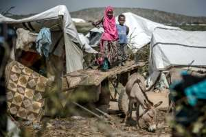 Repeated disasters are grinding down resilience, say experts. Climate victims have no time to rebuild homes and food stocks before the next extreme weather event strikes -- a challenge worsened by Somalia's conflict.  By LUIS TATO (AFP)