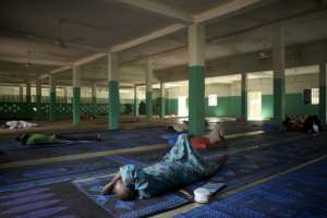 Rest is important during the holy month of Ramadan, even in the mosque.  By MICHELE CATTANI (AFP)