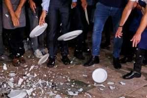 Restaurant workers in Tel Aviv break plates in protest against the new Israeli lockdown.  By JACK GUEZ (AFP/File)