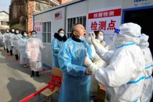 Residents of Shijiazhuang in northern Hebei, China line up for Coronavirus tests.  By STR (CNS/AFP)