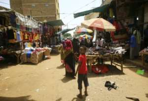 Residents of Omdurman walk through the market district in the Sudanese capital's twin city.  By Ashraf SHAZLY (AFP)