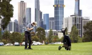 Residents of Melbourne dashed back to reopened salons and golf courses.  By William WEST (AFP)