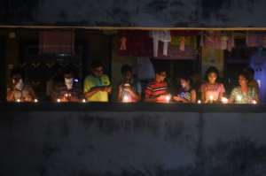 Residents light candles and turn on their mobile phone lights to observe a nine-minute vigil in India.  By Punit PARANJPE (AFP)
