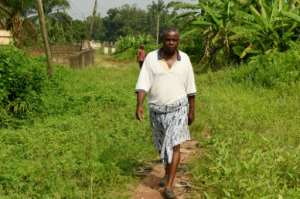 Retired civil servant Sunday Otoide has seen his pension hit by the devaluation of Nigeria's naira currency