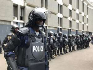 Riot police deployed outside an annex of the Capitol Building, the seat of the Liberian parliament.  By CARIELLE DOE (AFP)