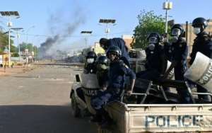 Riot police officers in Niamey clashed with opposition demonstrators on Tuesday.  By Issouf SANOGO (AFP/File)