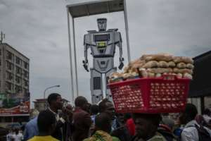 Robot cop: In 2015, the Kinshasa authorities installed three giant figures, equipped with lights and camera monitors, to try to unsnarl intersections.  By FEDERICO SCOPPA (AFP)