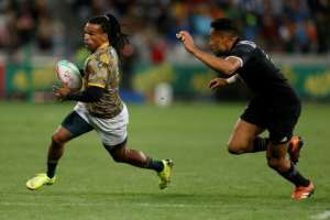 Rosko Specman (L), who scored two tries for the Bulls in his Super Rugby debut, playing for South Africa against New Zealand in a sevens international..  By GIANLUIGI GUERCIA (AFP/File)