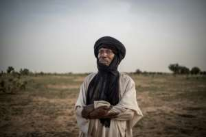 Rouada Sabgari, an elderly herder, wonders if his children will be able to carry on their ancient herding traditions.  By Marco LONGARI (AFP)