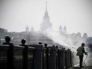 Russia, where municipal workers are disinfecting Moscow's streets, gas now closed its border to slow the spread of coronavirus.  By Alexander NEMENOV (AFP)