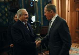 Russian Foreign Minister Sergei Lavrov (R) welcomed Libya's military strongman Khalifa Haftar (L) in Moscow.  By HO (RUSSIAN FOREIGN MINISTRY/AFP)